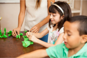kids in a clay art activity